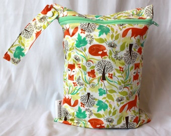 "wet bag in adorable fanciful foxes print 9""x12"". Perfect travel size. Will fit approx 4 cloth diapers."