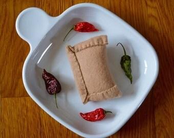 Chilean empanada. Specialty gourmet felt food for foodies. Empanada chilena pretend play food by la Marmota Café.