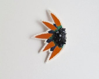 Abstract embroidered brooch starburst design with green, orange and blue colors and shimmery blue goldstone gems Spring Summer fashion