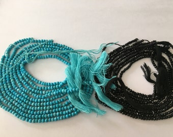 Turquousie and black spinel beads 5 strands each 14 inches each