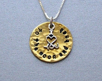 I love you to the moon and back pendant necklace of hammered brass with a sterling silver I (heart) you charm on a sterling silver chain.