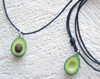 best friends TINY (1/2inch) avocado halves  braceletes or necklaces on black waxed cotton cord,pair braceletes or necklaces.Set of 2 halfs.