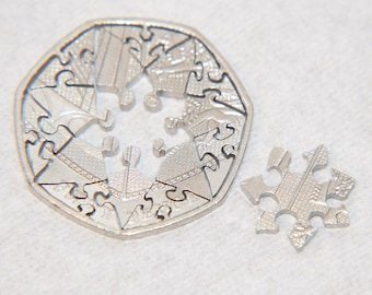 Heptagram. Coin cut interlocking jigsaw puzzle. 16 pcs. 50 pence british recycled circulated coin