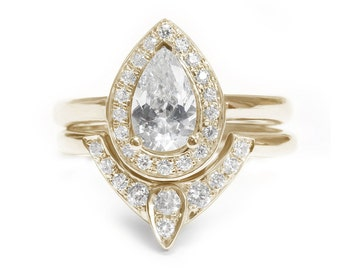 Pear Shaped Moissanite Engagement Ring with Matching Side Diamond Band