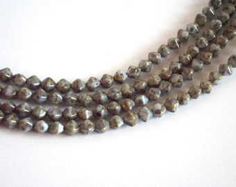 33 Brown, Pale Green, Beige Mix Czech Glass Bicone shaped beads measuring 4x6mm