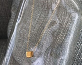 One Tiny Golden Necklace