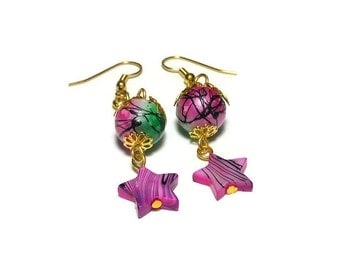 Star earrings, handmade pink mother of pearl stars and pink and green painted glass beads dangle merrily on a gold chain, with french hooks