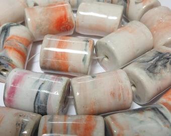 Bead, porcelain, marbled white/orange/dark grey, from 18x14mm to 22x16mm round tube 15-inch strand, 20 beads