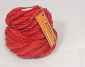 Russet reds thick and thin yarn. Hand spun, hand dyed slub. Pure Australian 21 micron merino wool.