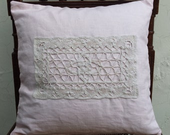 Tender pink linen cushion cover with a vintage rectangular ivory doily