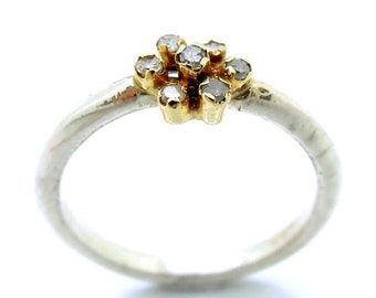 Diamond engagement ring set in gold and a silver band