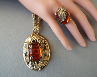 Whiting and Davis thistel pendant  necklace  and thistle ring amber glass