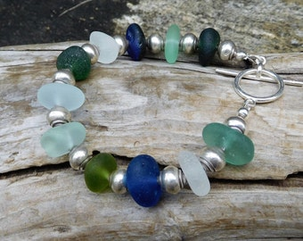 Genuine sea glass bracelet.  Hand gathered.  Not altered.  Lovely large pieces of glass with Bali Silver spacer beads.