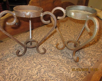 Pretty pair of large metal candle holders