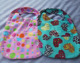 Girly Print SMALL REVERSIBLE BIBS with Pocket and Velcro Fastner.