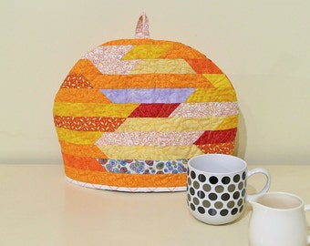 A quilted patchwork tea cozy in orange stripe, bright and cheerful tea cozy, orange tea cosy, large tea cosy