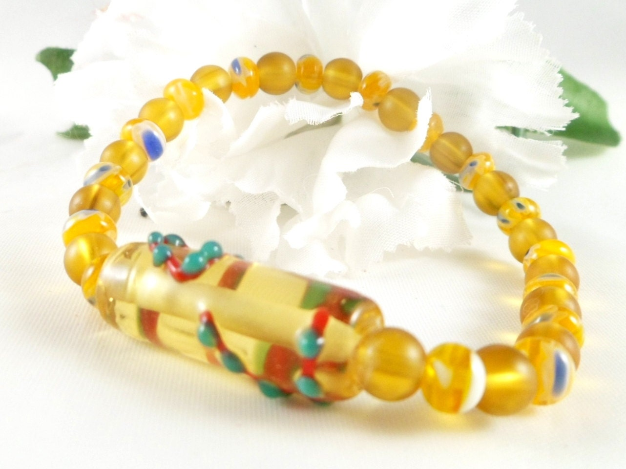 yellow bead bracelet with lwork focal bead by