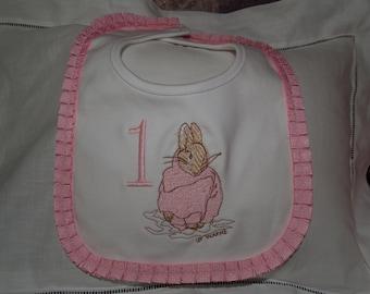 First Birthday Peter Rabbit Pink and White Cotton  Bib