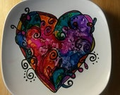 Contemporary/modern home decor - abstract heart design in purple, blue, and pink on white glazed plate
