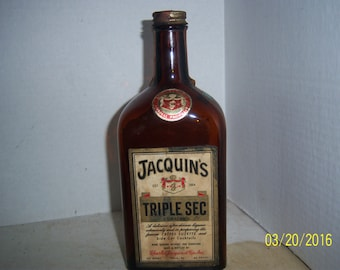 1960's Jacquin's Triple Sec Curacao Phila Pa Whiskey Bottle 8 3/4 inches tall with labels