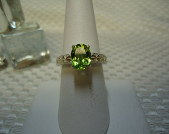 Oval Cut Peridot Ring in Sterling Silver