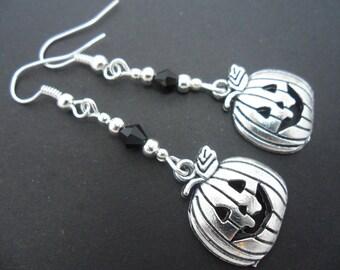A pair of hand made pumpkin  tibetan silver dangly halloween earrings.