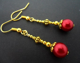 A pair of pretty gold plated red  glass pearl bead dangly earrings.