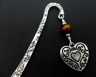A tibetan silver & tigers eye  bead  heart charm bookmark.