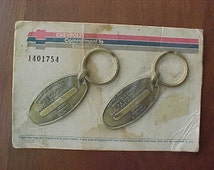 1980s Chevrolet COMMITMENT to EXCELLENCE  Key RingS Mint Sealed on Original Cardboard Rare New Old Stock Item Solid Brass Return to Owner