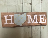 Home sign with blue fabric and tiny gold deer heads