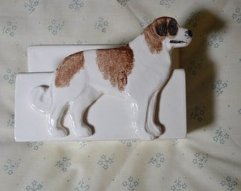 A Ceramic Letter Holder With a Saint Bernard on the Front