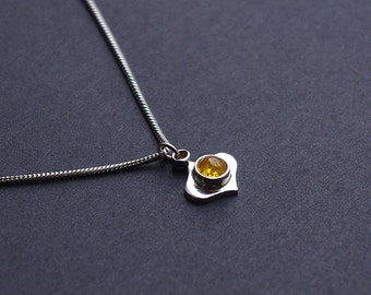 Handmade sterling silver pendant with amber