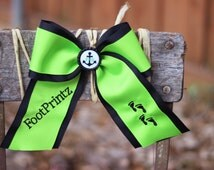 Custom cheer bow with bottle cap middles