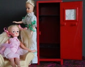 Two Sindy dolls, chair and locker