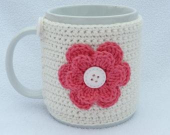 Cream and pink crochet mug cozy