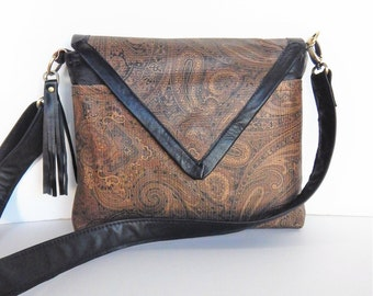 Paisley leather crossbody bag, or leather shoulder bag in browns with black trim.