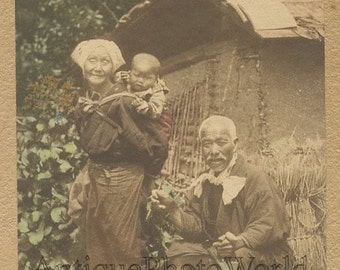 Japan old peasant couple w child antique tinted photo