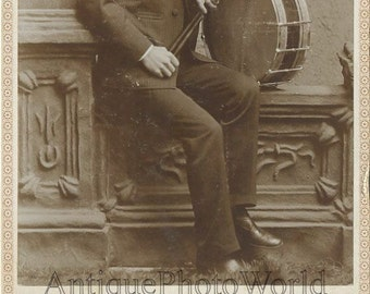 Man with drum antique cabinet photo Wisconsin