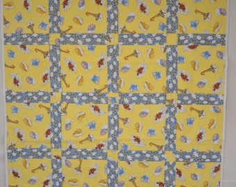 Beautiful quilted baby blanket or lap quilt, machine pieced and quilted perfect for a new baby to cuddle and love on