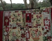 Merry Christmas garden seasonal lap quilt or wall hanging.