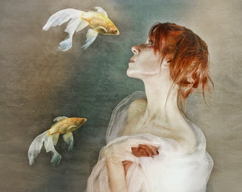 A Connection is a surrealistic, painterly portrait of woman surrounded by Angelfish with a background of blue and gold