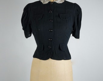 Classic 1950's vintage black light linen blouse with short puff sleeves and lace peter pan collar