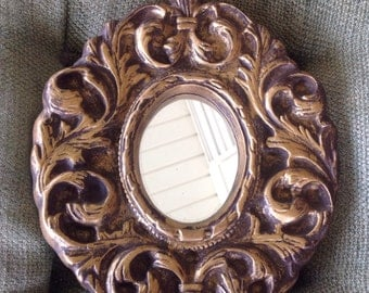 Intricate gold cast fancy mirror