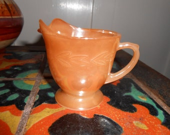 Vintage Fire King Orange Opalescent Creamer