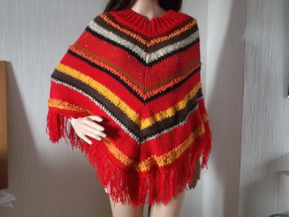 Retro style poncho in reds, brown, and orange colours of Autumn hand knitted from up-cycled yarn