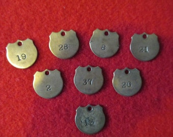1920's brass tags