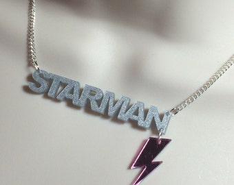 "laser cut silver Acrylic ""STARMAN"" David Bowie influenced necklace"