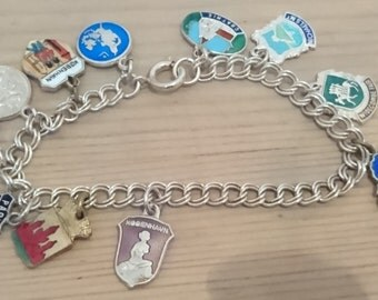 Vintage sterling silver charm bracelet with 11 shields
