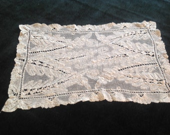 handworked antique lace placements, two of them
