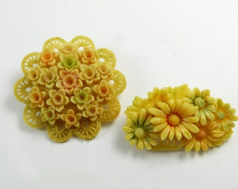 Celluloid Occupied Japan Carved Flower Brooch Pair